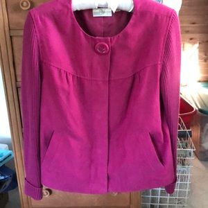 Fuchsia suede type jacket with knit sleeves.